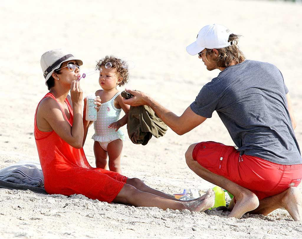 "Oscar winner Halle Berry and her beau, French-Canadian supermodel Gabriel Aubry, play with their daughter, Nahla, on the beach in Miami. Ralph Notaro/<a href=""http://www.splashnewsonline.com"" target=""new"">Splash News</a> - July 8, 2009"