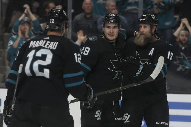San Jose Sharks right wing Timo Meier, center, is congratulated by Patrick Marleau (12) and Joe Thornton after scoring a goal against the Buffalo Sabres during the first period of an NHL hockey game in San Jose, Calif., Saturday, Oct. 19, 2019. (AP Photo/Jeff Chiu)