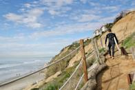 """<p><strong>Let's start big picture here.</strong><br> Winding down the sandy path to Beacon's Beach, visitors are greeted by a patchwork of greenery on the sloping hills, and long surf breaks crashing in the sea below. With a neighborhood feel on the sand—and plenty of it for sunbathers—this beach is a local favorite.</p> <p><strong>Any standout features or must-sees?</strong><br> Before heading out to the beach, stop by <a href=""""https://pannikincoffeeandtea.com/"""" rel=""""nofollow noopener"""" target=""""_blank"""" data-ylk=""""slk:Pannikin Coffee & Tea"""" class=""""link rapid-noclick-resp"""">Pannikin Coffee & Tea</a>, located in a large yellow house close by, for a latte and a slice of homemade pie or a fresh-baked muffin. Who knows, you may even catch pro-skateboarder Tony Hawk a Pannikin regular, dining alongside you.</p> <p><strong>Was it easy to get around?</strong><br> Since there are no restrooms, and beach access here requires effort, this typically isn't a beach frequented by families with children, nor those with mobility issues. There is a small parking lot and limited street parking, so prepare for a little bit of a walk. Once on the beach, though, that walk means you'll have plenty of space to yourself.</p> <p><strong>All said and done, what—and who—is this best for?</strong><br> Some of San Diego's beaches can have a universally appealing, something-for-everyone, slightly vanilla feel to them. Beacon's Beach is the cool cousin, posing just the right amount of inconvenience to weed out the masses of tourists, despite being as picturesque as San Diego's most popular beaches. The result is a laid-back, mainly local crowd that you won't find just anywhere. Travelers in search of this will love Beacon's; families or those desiring greater convenience and facilities should go elsewhere.</p>"""
