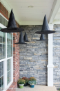 """<p>Light the way for trick-or-treaters with these whimsical luminaries — or hang battery-operated tapers from the ceiling just like <em>Harry Potter</em>.</p><p><em><a href=""""http://www.polkadotchair.com/2015/09/floating-witch-hat-luminaries.html/#_a5y_p=4332188"""" rel=""""nofollow noopener"""" target=""""_blank"""" data-ylk=""""slk:Get the tutorial at Polkadot Chair »"""" class=""""link rapid-noclick-resp"""">Get the tutorial at Polkadot Chair »</a></em> </p>"""