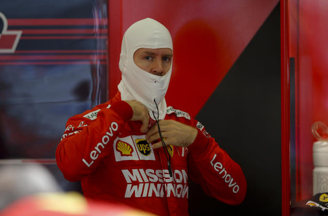Ferrari driver Sebastian Vettel, of Germany, prepare at the pit lane during the first training session of the Formula One Mexico Grand Prix auto race at the Hermanos Rodriguez racetrack in Mexico City, Friday, Oct. 25, 2019. (AP Photo/Eduardo Verdugo)