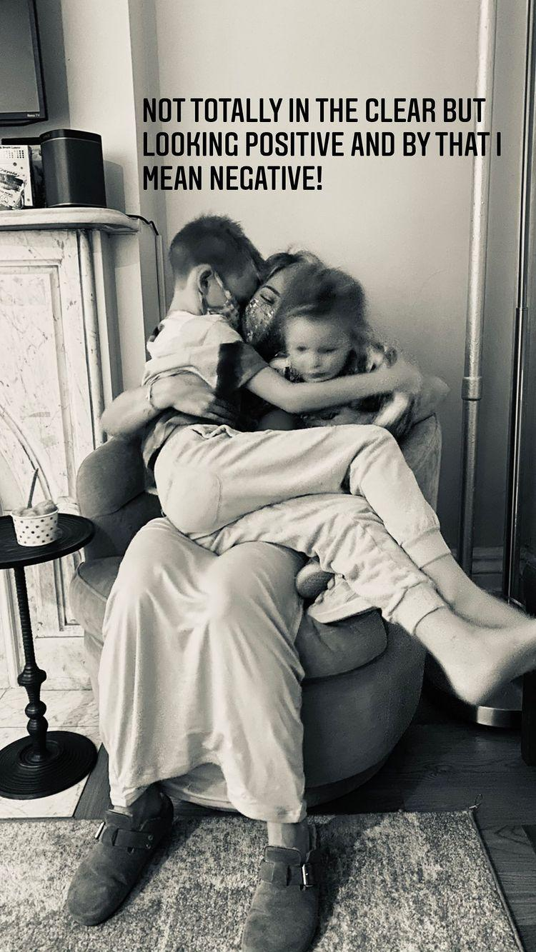 Duff posted a photo with her 8 and 2-year-old children after getting negative results from a rapid test. (Photo: Instagram)