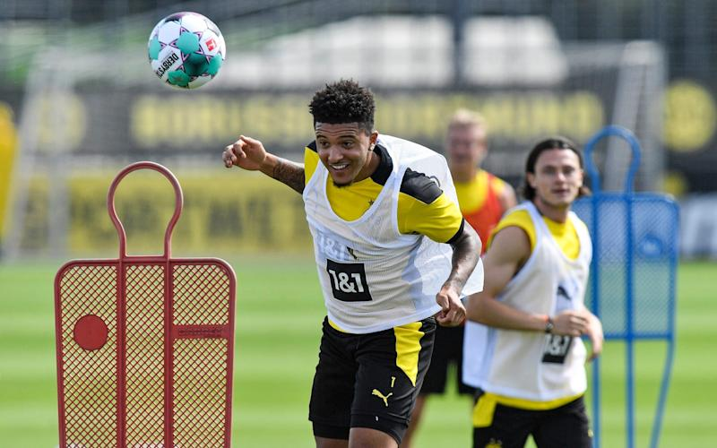 Dortmund's Jadon Sancho heads the ball during the first training session of German Bundesliga club Borussia Dortmund at the training grounds in Dortmund, Germany, Monday, Aug. 3, 2020. - AP