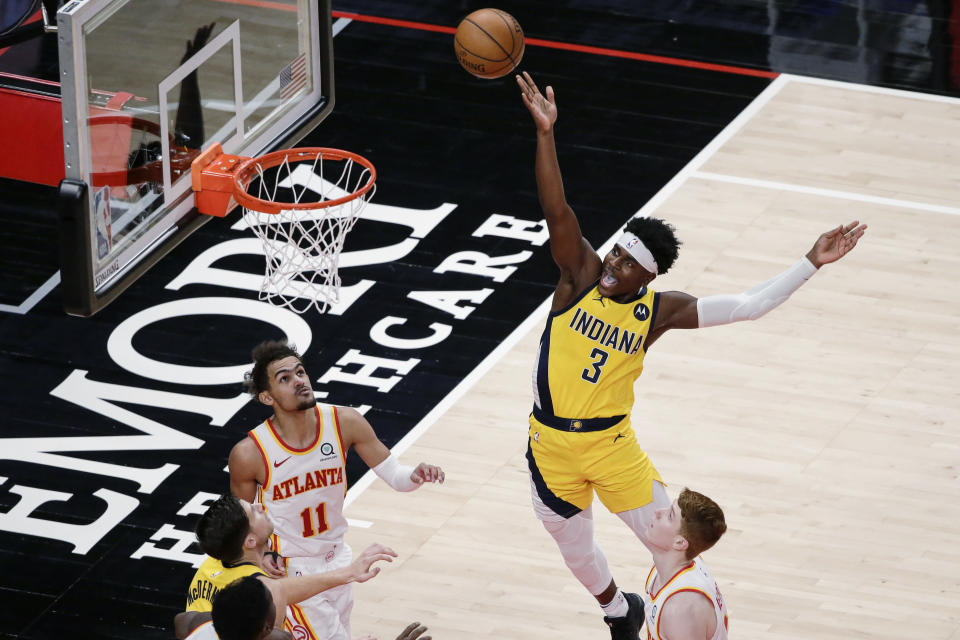 Indiana Pacers guard Aaron Holiday (3) shoots against the Atlanta Hawks during the fourth quarter of an NBA basketball game Saturday, Feb. 13, 2021, in Atlanta. (AP Photo/Butch Dill)