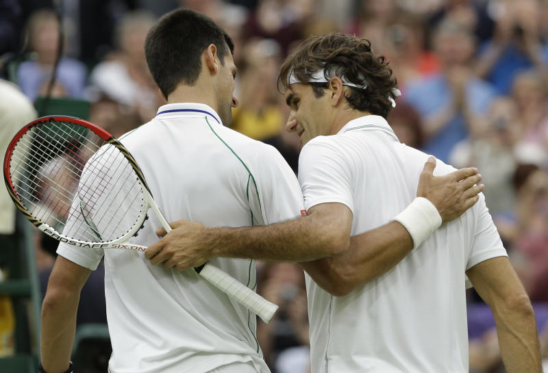 Novak Djokovic of Serbia, left, and Roger Federer of Switzerland, right, walk off the court after Federer won their semifinals match at the All England Lawn Tennis Championships at Wimbledon, England, Friday, July 6, 2012. (AP Photo/Anja Niedringhaus)