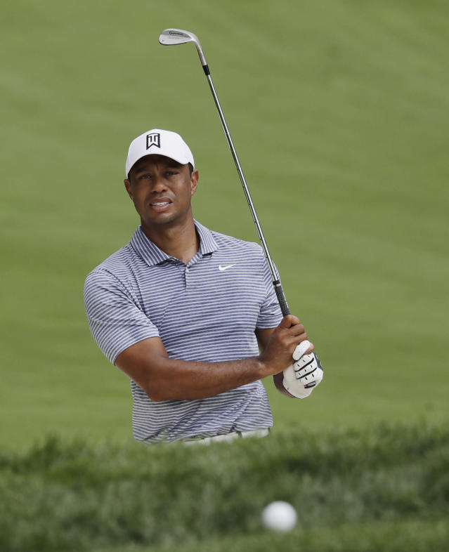 Tiger Woods watches his ball after hitting from a sand trap on the 14th hole during the pro-am round of the BMW Championship golf tournament at Medinah Country Club, Wednesday, Aug. 14, 2019, in Medinah, Ill. (AP Photo/Nam Y. Huh)