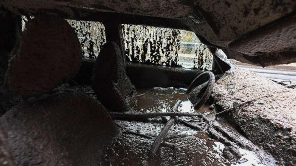 PHOTO: Mud fills the interior of a car destroyed in a rain-driven mudslide in a neighborhood under mandatory evacuation in Burbank, Calif., Jan. 9, 2018. (Robyn Beck/AFP/Getty Images)