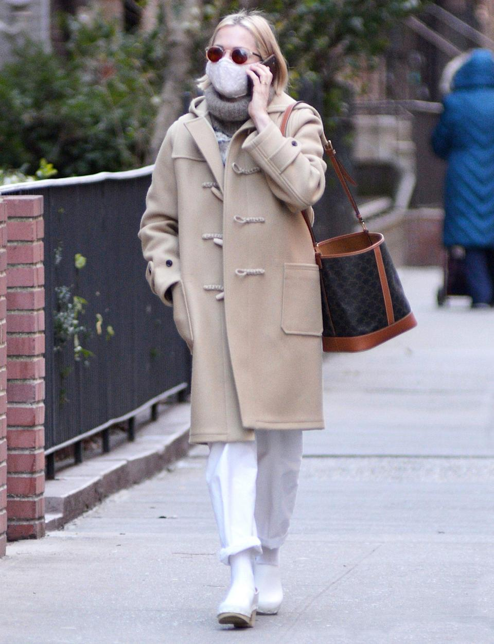 <p>Michelle Williams steps out in a tan winter coat and white trousers as she chats on the phone while walking through N.Y.C. on Sunday.</p>