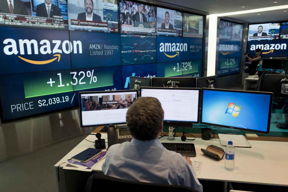 FILE- In this Sept. 4, 2018, file photo a Nasdaq employee monitors market activity in New York. When this bull market was born 10 years ago, just one of the most valuable companies in the market was a technology stock. Now, it's four out of five. (AP Photo/Mark Lennihan, File)