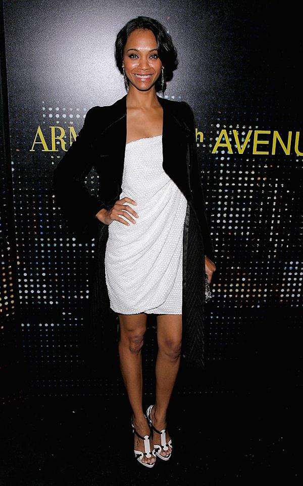 """Zoe Saldana wrapped a towel around her body and topped off her look with a black overcoat. Jemal Countess/<a href=""""http://www.wireimage.com"""" target=""""new"""">WireImage.com</a> - February 17, 2009"""