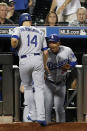 Los Angeles Dodgers manager Dave Roberts, right, greets Enrique Hernandez (14) at the dugout steps after he scored the Dodgers' go-ahead run on Jedd Gyorko's ninth-inning RBI single in a baseball game against the New York Mets, Sunday, Sept. 15, 2019, in New York. (AP Photo/Kathy Willens)