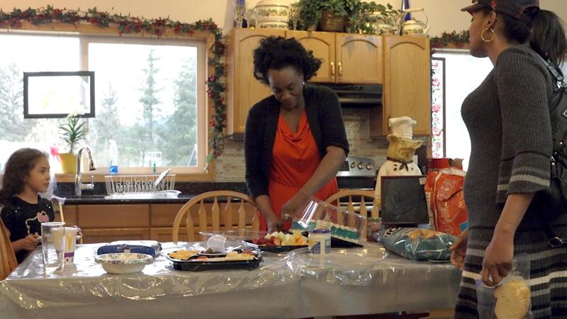 Alaska -Juneau, Alaska - Rena Sims, her daughter Nicole Robinson-Wells and her grandaugter, prepare food at their home in Juneau, Alaska. Sims has fostered over 300 children, many of which have been abused prior to living with her. [Via MerlinFTP Drop]