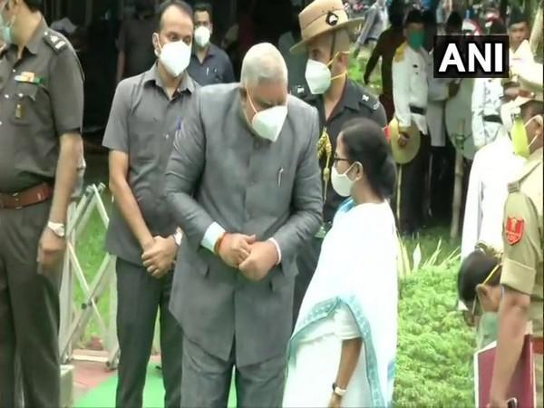 West Bengal Governor Jagdeep Dhankhar meets Chief Minister Mamata Banerjee as he arrives at the state Assembly in Kolkata. (Photo/ANI)