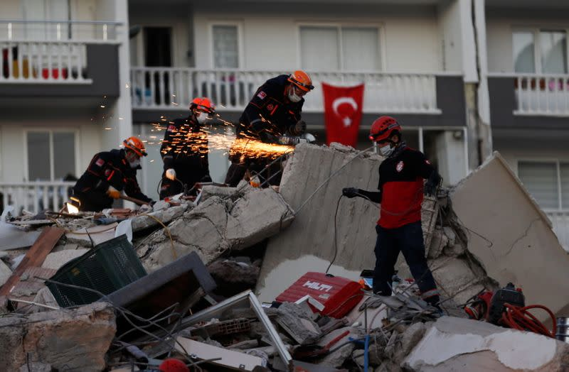 Rescue operations take place on a site after an earthquake struck the Aegean Sea, in the coastal province of Izmir