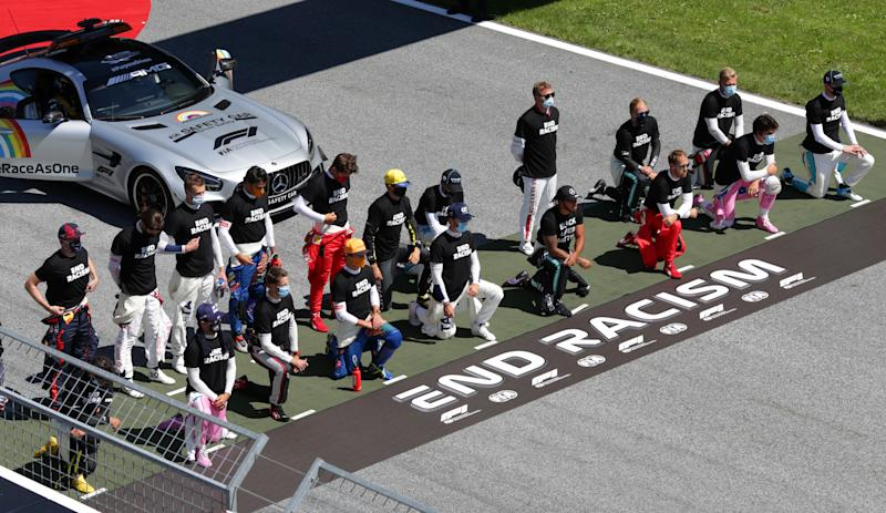 SPIELBERG, AUSTRIA - JULY 05: Some of the F1 drivers take a knee on the grid in support of the Black Lives Matter movement ahead of the Formula One Grand Prix of Austria at Red Bull Ring on July 05, 2020 in Spielberg, Austria. (Photo by Peter Fox/Getty Images)