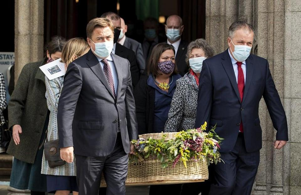 John Hume Jnr (left) and his brother Aidan (right) carry the coffin of their mother Pat Hume (Liam McBurney/PA) (PA Wire)