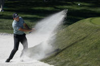 Sergio Garcia, of Spain, hits from the bunker on the ninth hole during the second round of the The Players Championship golf tournament Friday, March 12, 2021, in Ponte Vedra Beach, Fla. (AP Photo/John Raoux)