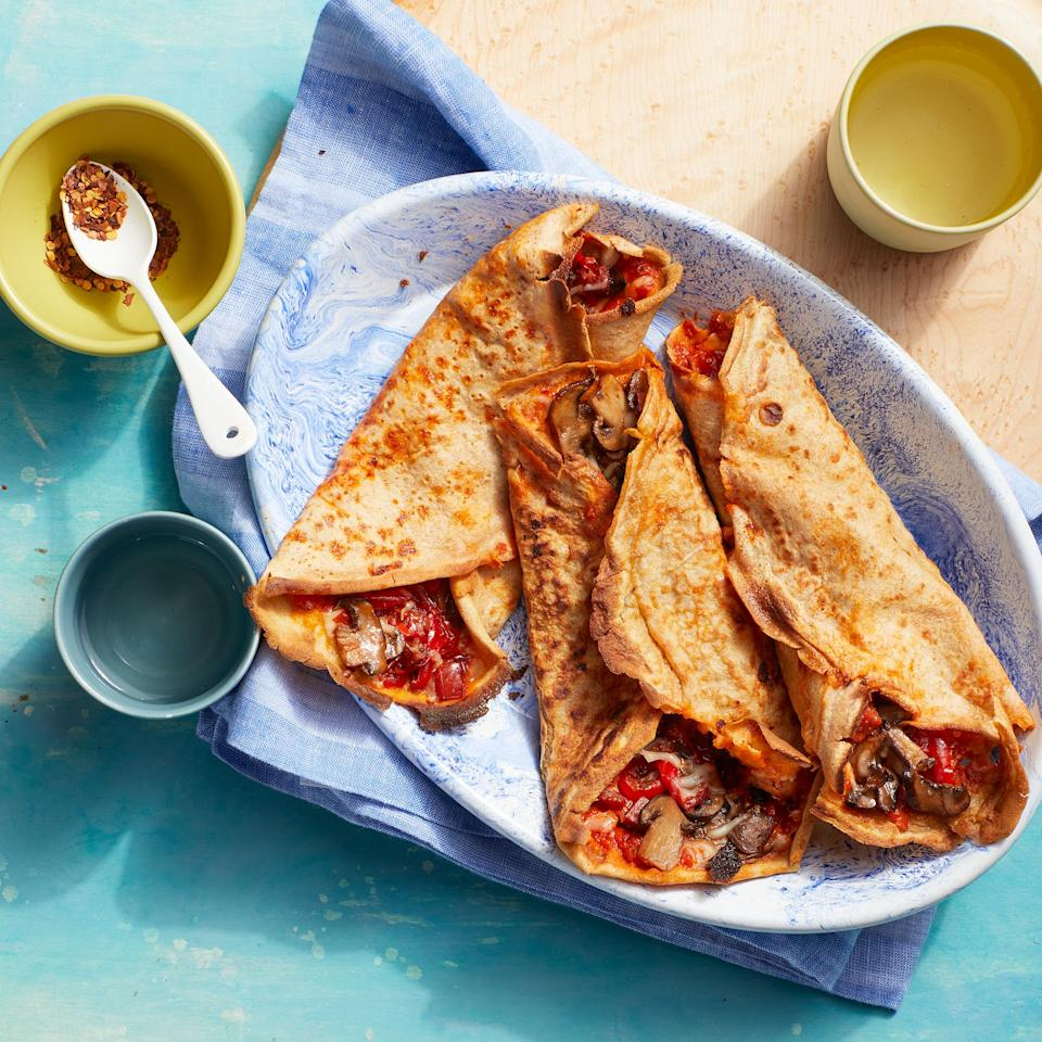 """<p>Crêpes may seem fancy-slash-scary, but once you get the hang of the process, making them is a snap—the eggs make them surprisingly sturdy. Fill them with just about anything, like ham and cheese with an egg on top for brunch or fresh fruit and Nutella for dessert. <a href=""""https://www.eatingwell.com/recipe/7897622/pizza-crepes/"""" rel=""""nofollow noopener"""" target=""""_blank"""" data-ylk=""""slk:View recipe"""" class=""""link rapid-noclick-resp""""> View recipe </a></p>"""