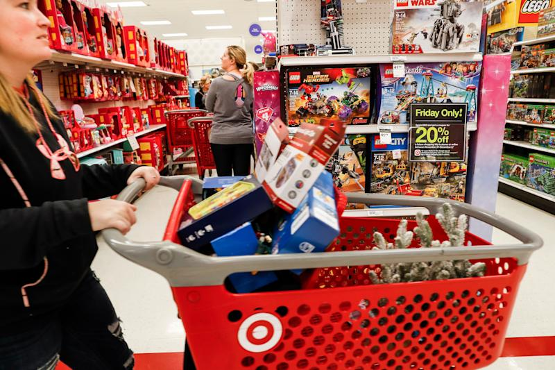 Shoppers browse the aisles during a Black Friday sale at a Target store, Friday, Nov. 23, 2018, in Newport, Ky. Black Friday isn't what it used to be. It has morphed from a single day when people got up early to score door busters into a whole month of deals. (AP Photo/John Minchillo)