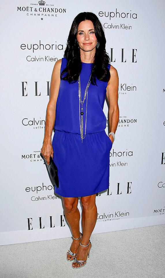 "Courteney Cox Arquette shows off her toned arms in this bright blue frock. Jeffrey Mayer/<a href=""http://www.wireimage.com"" target=""new"">WireImage.com</a> - October 6, 2008"