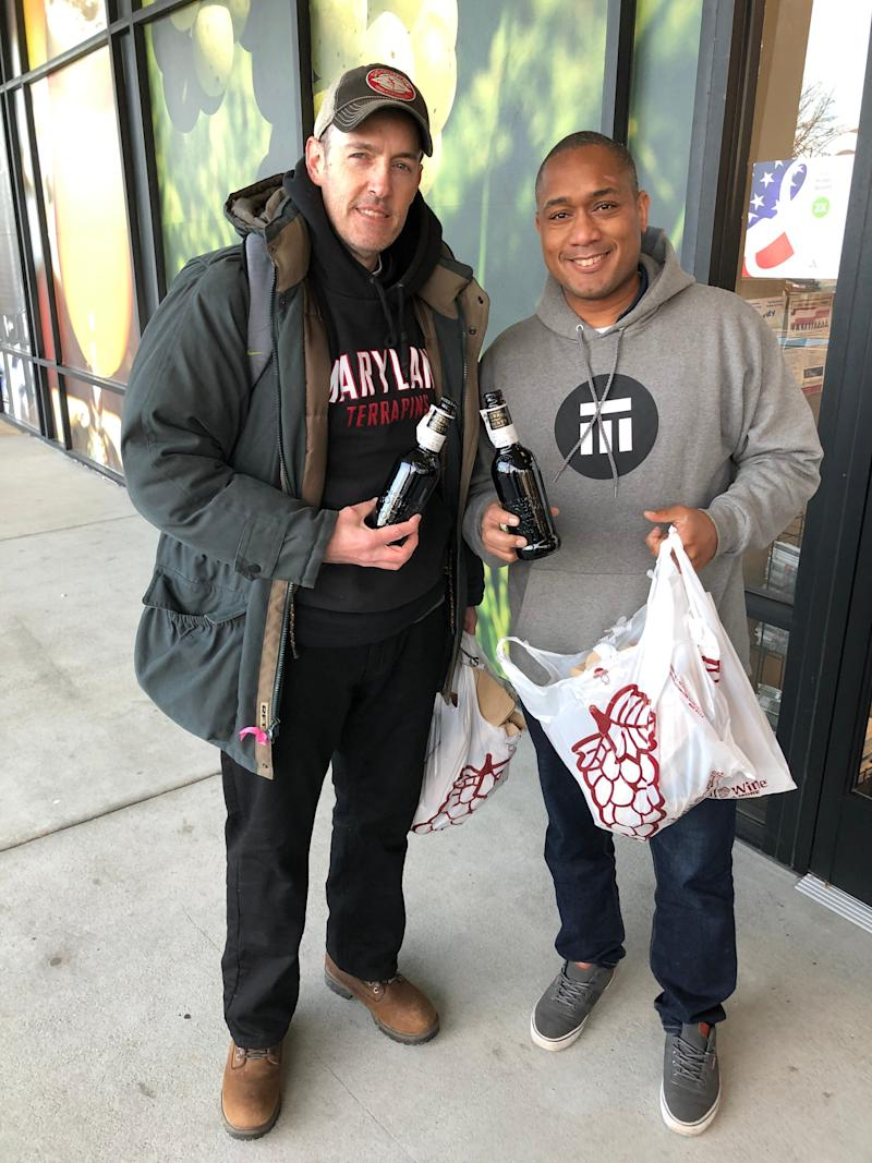 Lee Lessick, Philadelphia, 46, at left, and Lee Wood of Lawton, Oklahoma, 37, show off their purchases of Goose Island Beer Co. Bourbon County Stout at the Total Wine & More store in McLean, Va. on Black Friday, Nov. 29, 2019.