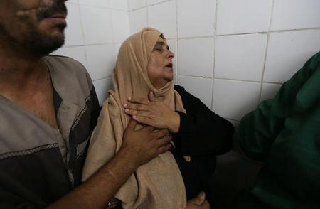 The mother of a Palestinian who was killed by Israeli troops east of Khan Younis, reacts at hospital in Gaza Strip