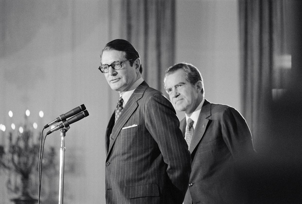 """<span class=""""s1"""">President Richard Nixon stands behind his new attorney general, Elliot Richardson, during Richardson's oath of office ceremony in May 1973. (Photo: Bettmann/Getty Images)</span>"""