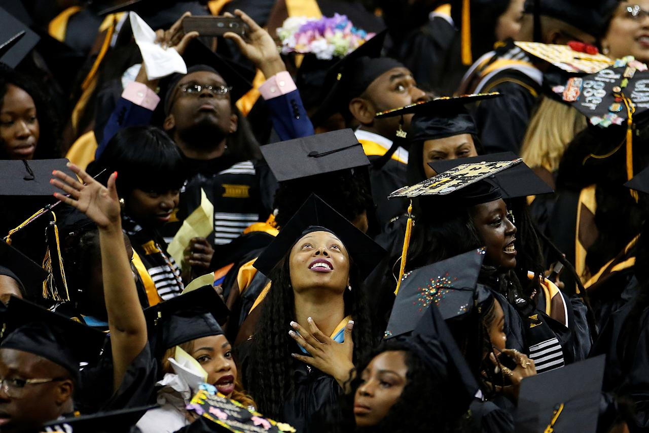 <p>Graduates look at the screen during a commencement for Medgar Evers College in the Brooklyn borough of New York City, New York, U.S., June 8, 2017. (Photo: Carlo Allegri/Reuters) </p>