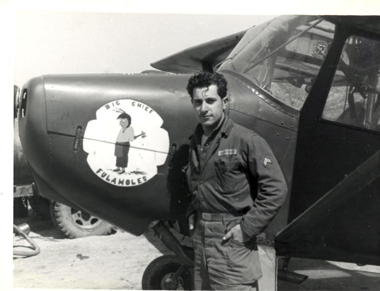 """This undated photograph provided by American Airlines shows Azriel """"Al"""" Blackman posing with an airplane while serving in the army during the Korean war. American Airlines is celebrating the 70-year service of a New York City mechanic who says he has no plans to retire. Azriel """"Al"""" Blackman was 16 years old when he started as an apprentice mechanic in July of 1942. (AP Photo/American Airlines)"""