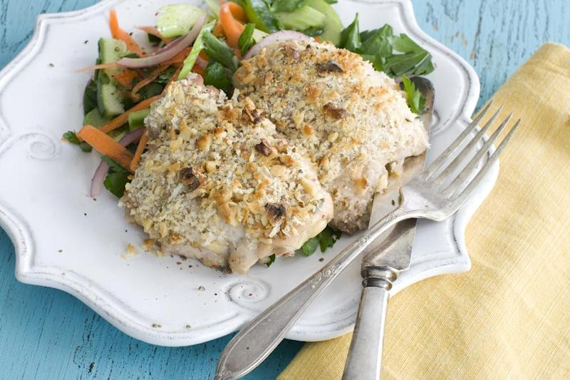 This March 18, 2013 photo taken in Concord, N.H. shows a recipe for herb-brined, walnut-crusted chicken thighs. (AP Photo/Matthew Mead)