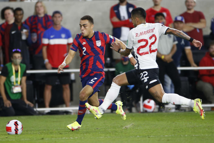 United States' Sergino Dest, left, dribbles the ball upfield as Costa Rica's Ronald Matarrita defends during the first half of a World Cup qualifying soccer match Wednesday, Oct. 13, 2021, in Columbus, Ohio. (AP Photo/Jay LaPrete)