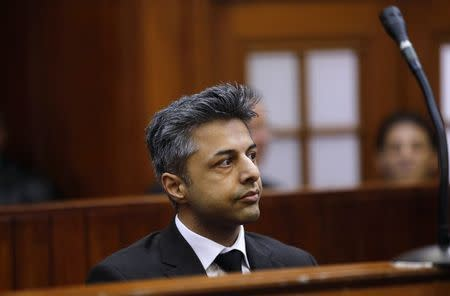 Honeymoon murder accused Shrien Dewani sits in the dock before the start of his trial in Cape Town