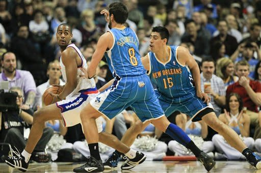 Denver Nuggets shooting guard Arron Afflalo (6) is double teamed by New Orleans Hornets' Marco Belinelli (8) and Lance Thomas (42) during the first quarter of an NBA basketball game Friday, March 9, 2012 in Denver. (AP Photo/Barry Gutierrez)