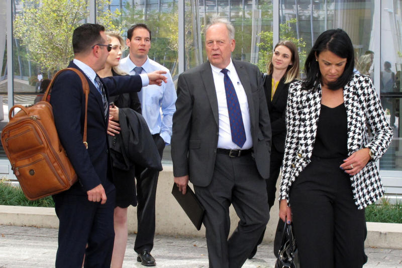 Fired doctor William Husel, third from left, leaves court with his new attorneys, Jose Baez, far left, and Diane Menashe, far right, and others following a hearing Wednesday, Aug. 28, 2019, in Columbus, Ohio. Husel is accused of ordering excessive painkiller doses for hospital patients and has pleaded not guilty to 25 counts of murder. (AP Photo/Kantele Franko)