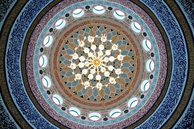 The interior of the dome of a mosque (Oli Scarff/AP)