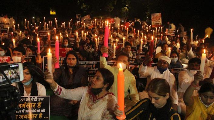 Activists of the Indian Youth Congress took out a candle light march at Jantar Mantar demanding justice for the Hathras gang-rape victim, who died at a government hospital in Delhi last month, on October 12, 2020 in New Delhi, India.
