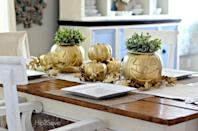 """<p>Make plastic pumpkins stand out with some gold spray paint and pretty greenery. </p><p><strong><a href=""""https://www.countryliving.com/diy-crafts/a39982/dollar-store-halloween-hack/"""" rel=""""nofollow noopener"""" target=""""_blank"""" data-ylk=""""slk:Get the tutorial."""" class=""""link rapid-noclick-resp"""">Get the tutorial.</a></strong></p><p><strong><a class=""""link rapid-noclick-resp"""" href=""""https://www.amazon.com/LUOEM-Halloween-Pumpkin-Portable-Children/dp/B07F1LZB3M/ref=sr_1_2?tag=syn-yahoo-20&ascsubtag=%5Bartid%7C10050.g.3739%5Bsrc%7Cyahoo-us"""" rel=""""nofollow noopener"""" target=""""_blank"""" data-ylk=""""slk:SHOP PUMPKIN CANDY BASKETS"""">SHOP PUMPKIN CANDY BASKETS</a></strong> </p>"""
