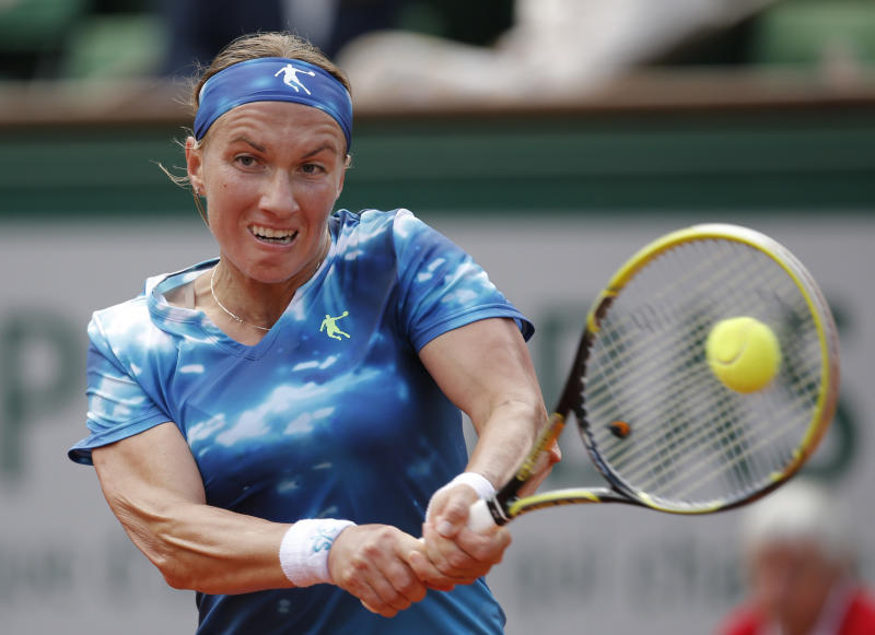 Svetlana Kuznetsova, of Russia, returns the ball to Germany's Angelique Kerber during their fourth round match of the French Open tennis tournament at the Roland Garros stadium Sunday, June 2, 2013 in Paris. (AP Photo/Christophe Ena)