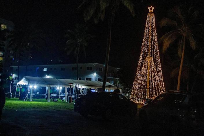 The North Bay Village commission meeting was held in a tent in a local dog park on Tuesday, Dec. 8, 2020, for COVID-19 safety reasons. Before the meeting, the village held a brief Christmas tree-lighting ceremony nearby.
