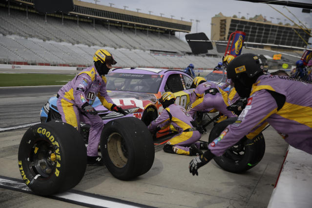 Kyle Busch makes a pit stop during the NASCAR Cup Series auto race at Atlanta Motor Speedway on Sunday, June 7, 2020, in Hampton, Ga. (AP Photo/Brynn Anderson)