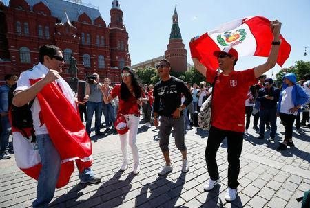 Supporters of the Peruvian national soccer team, a participant of the soccer World Cup, react during a gathering near the State Historical Museum and the Kremlin in central Moscow, Russia June 15, 2018. REUTERS/Gleb Garanich