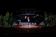 Chinese President Xi Jinping is seen on a giant screen during a cultural performance in Macau