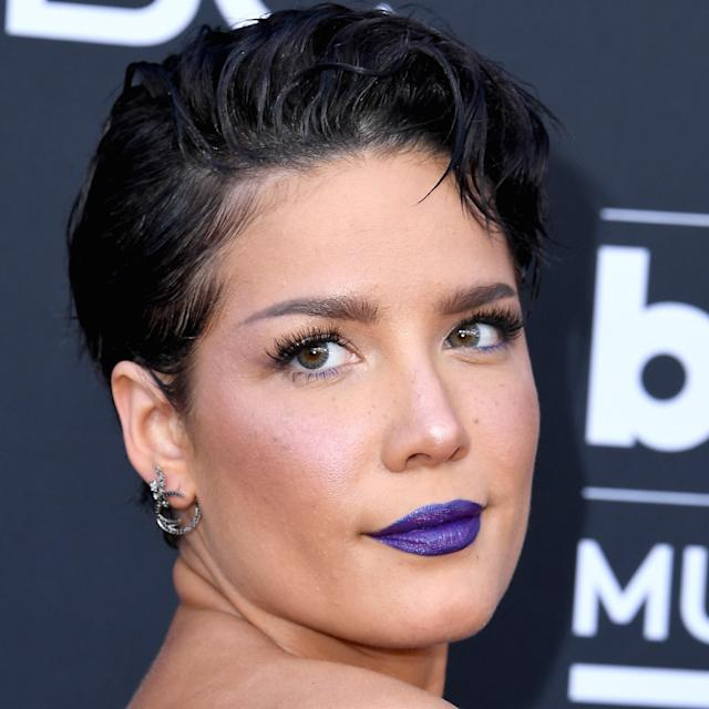 Halsey's Billboard Music Awards look changed several times throughout the night, but her red-carpet makeup was arguably the most memorable. Matching her gorgeous gown, Halsey's lips were painted a stunning shade of purply blue with a hint of eye-catching shimmer. But that's not the only feature that pulled in the color of her dress. Take a close look and you'll see that Halsey's lower lashes are also coated in an indigo mascara, and even her blush has a bluish undertone.