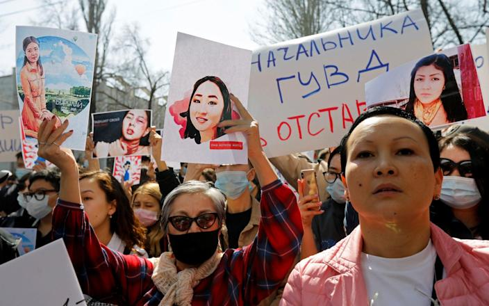 People attend a rally in front of Kyrgyzstan's interior ministry in Bishkek - VLADIMIR