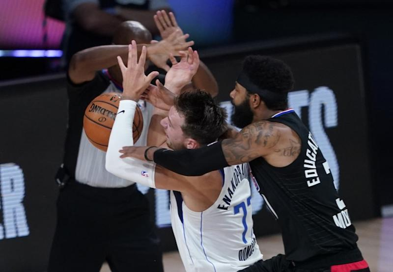 Dallas Mavericks fo Luka Doncic (77) is fouled by Los Angeles Clippers' Marcus Morris Sr.