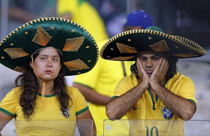 Brazil fans grieve after the World Cup semifinal match. (AP)