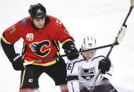 Los Angeles Kings' Blake Lizotte, right, is knocked down by Calgary Flames' Milan Lucic during the second period of an NHL hockey game Saturday, Dec. 7, 2019, in Calgary, Alberta. (Larry MacDougal/The Canadian Press via AP)