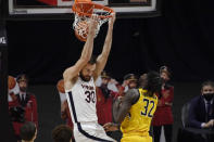 Virginia's Jay Huff dunks as Towson's Charles Thompson defends in the first half of an NCAA college basketball game, Wednesday, Nov. 25, 2020, in Uncasville, Conn. (AP Photo/Jessica Hill)