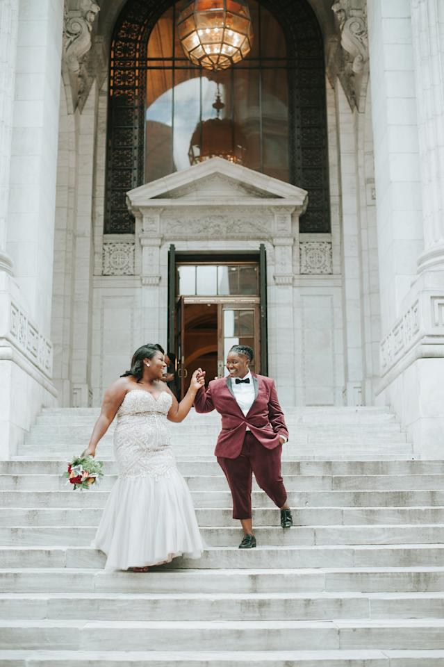 """<p>After meeting Denisha at work, Bri was instantly captivated. The two started seeing each other soon after, and tied the knot at their destination <a class=""""sugar-inline-link ga-track"""" title=""""Latest photos and news for wedding"""" href=""""https://www.popsugar.com/Wedding"""" target=""""_blank"""" data-ga-category=""""Related"""" data-ga-label=""""https://www.popsugar.com/Wedding"""" data-ga-action=""""&lt;-related-&gt; Links"""">wedding</a> in New York. Bri and Denisha fell in love with the New York Public Library and exchanged their vows right next to the steps with a whole crowd watching. <a href=""""https://www.popsugar.com/love/new-york-public-library-elopement-47536924"""" class=""""ga-track"""" data-ga-category=""""Related"""" data-ga-label=""""https://www.popsugar.com/love/new-york-public-library-elopement-47536924"""" data-ga-action=""""In-Line Links"""">See Bri and Denisha's wedding here.</a></p>"""