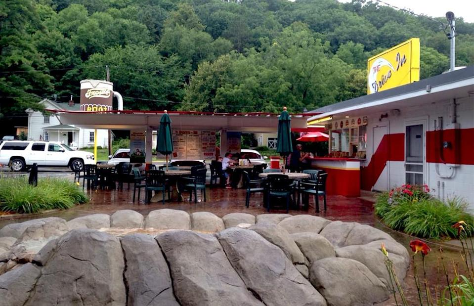 """<p>What drive-in? Well, <em>The</em> Drive In in Taylors Falls, Minnesota. While this place has an old-fashioned vibe with carhops in poodle skirts and vintage-looking menus, <a href=""""https://www.thedailymeal.com/eat/biggest-craziest-food-trends-2010s?referrer=yahoo&category=beauty_food&include_utm=1&utm_medium=referral&utm_source=yahoo&utm_campaign=feed"""" rel=""""nofollow noopener"""" target=""""_blank"""" data-ylk=""""slk:the food is on-trend for today"""" class=""""link rapid-noclick-resp"""">the food is on-trend for today</a>. Dishes are made with local beef, locally-baked goods and local, organic milk. Even the root beer is made fresh on-site every day.</p>"""